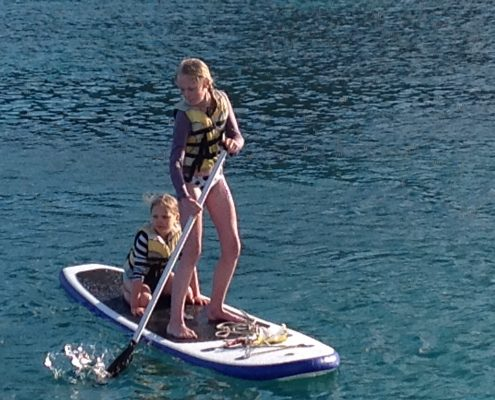 Children Paddle Boarding in Mallorca